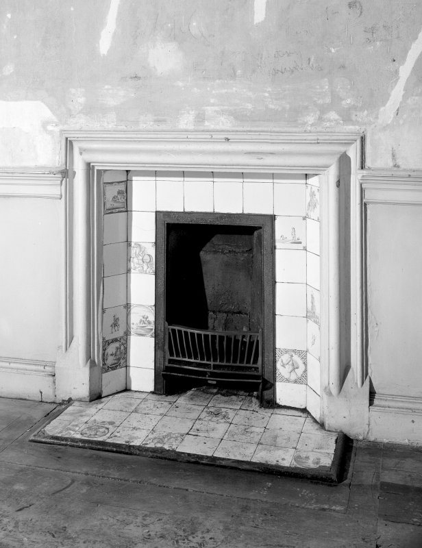 Interior. Detail of fireplace in ground floor central apartment.