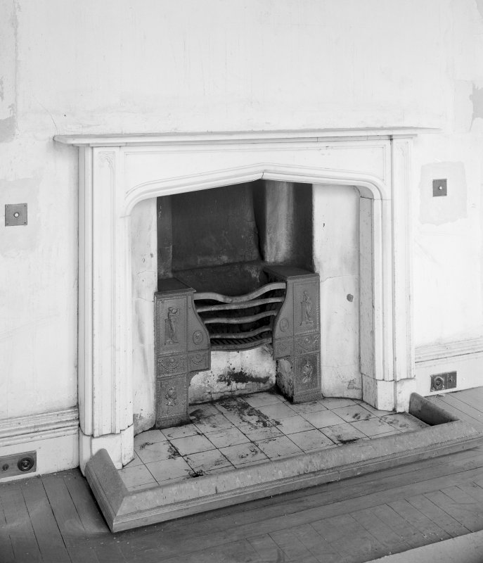 Interior. Detail of fireplace in ground floor North-West apartment.