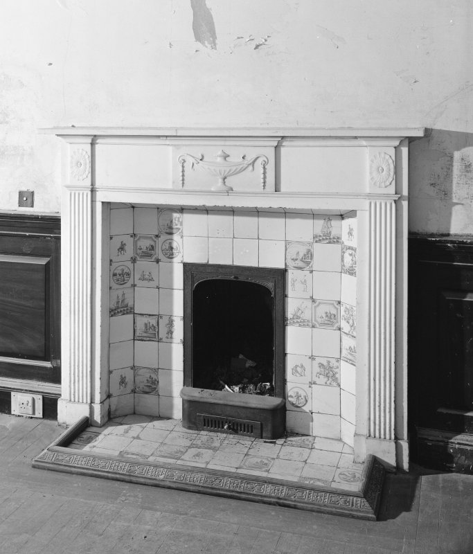 Interior. Detail of fireplace in ground floor South-West apartment.