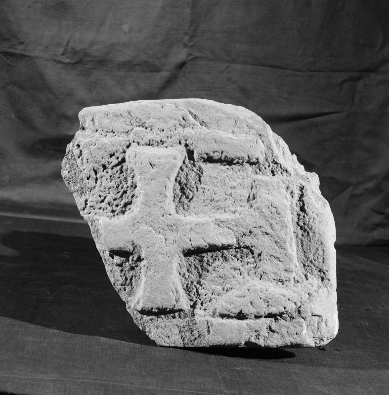 View of fragment of cross slab with a cross carved in relief from Whithorn.