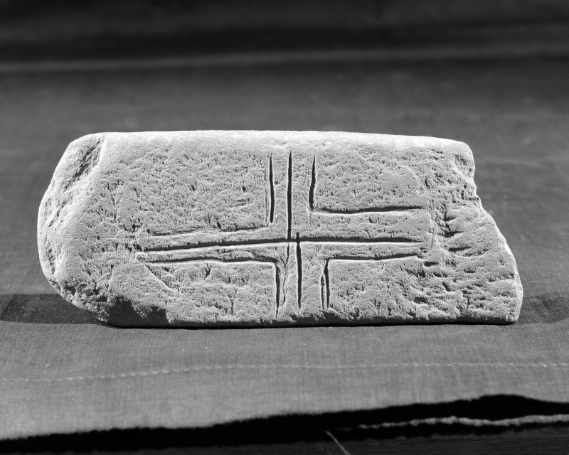 View of fragment of small cross-slab with an incised cross from  Whithorn.