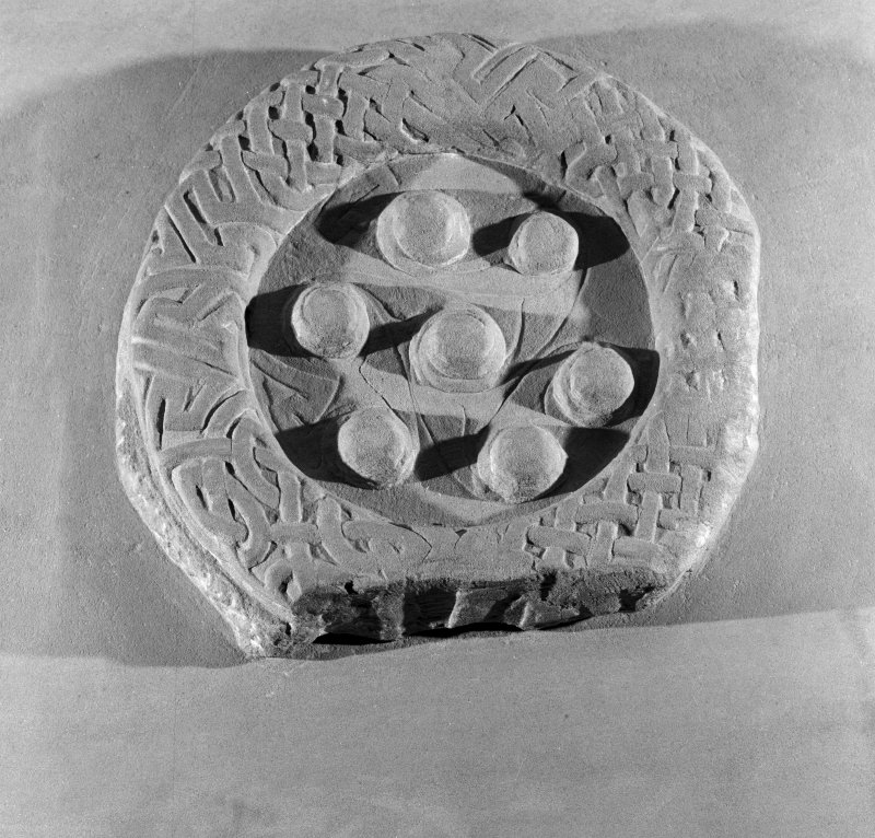 View of raised ring and bosses on modern replica fragment Tarbat 5, at Portmahomack.