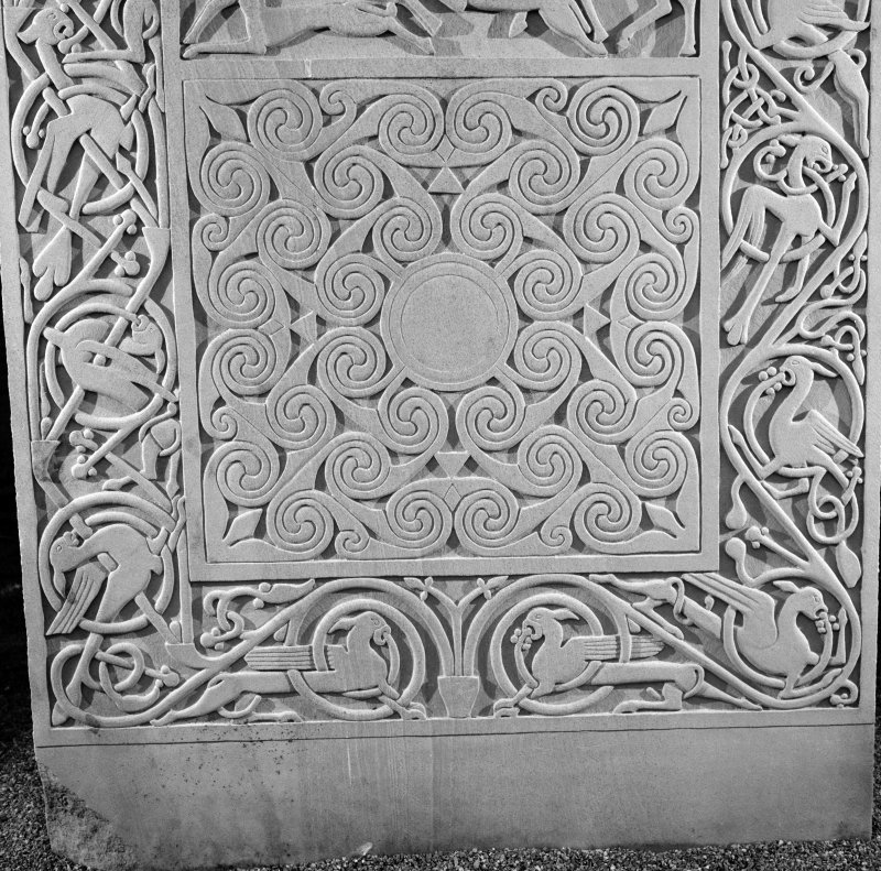 Detail of the spirals panel and vine scroll border on the modern reconstruction sculpture by Barry Groves, representing face C of the cross-slab found at Hilton of Cadboll. The modern version stands close to the chapel site.