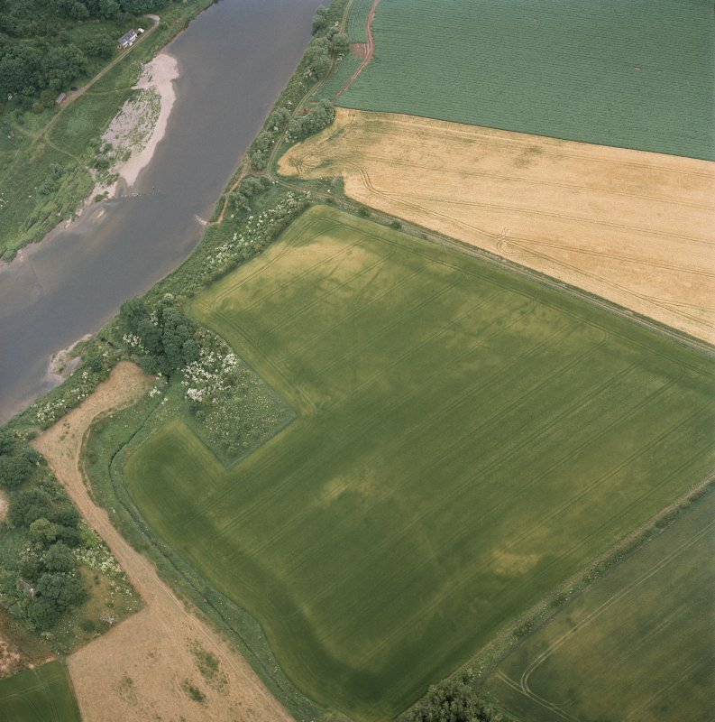 Oblique aerial view centred on the cropmarks of the deserted medieval village, taken from the E.