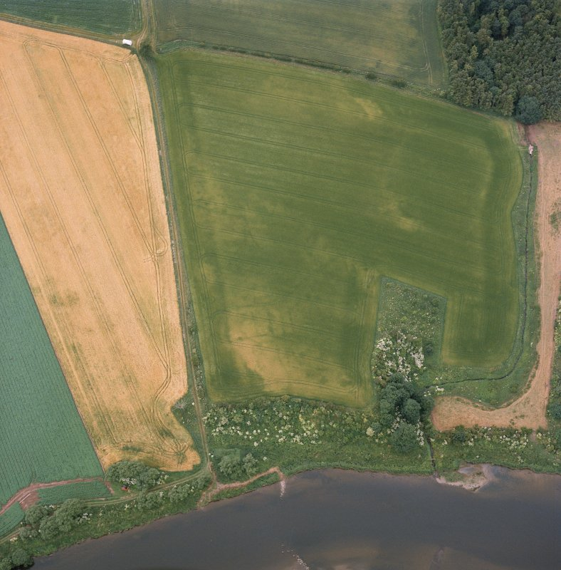 Oblique aerial view centred on the cropmarks of the deserted medieval village, taken from the NW.