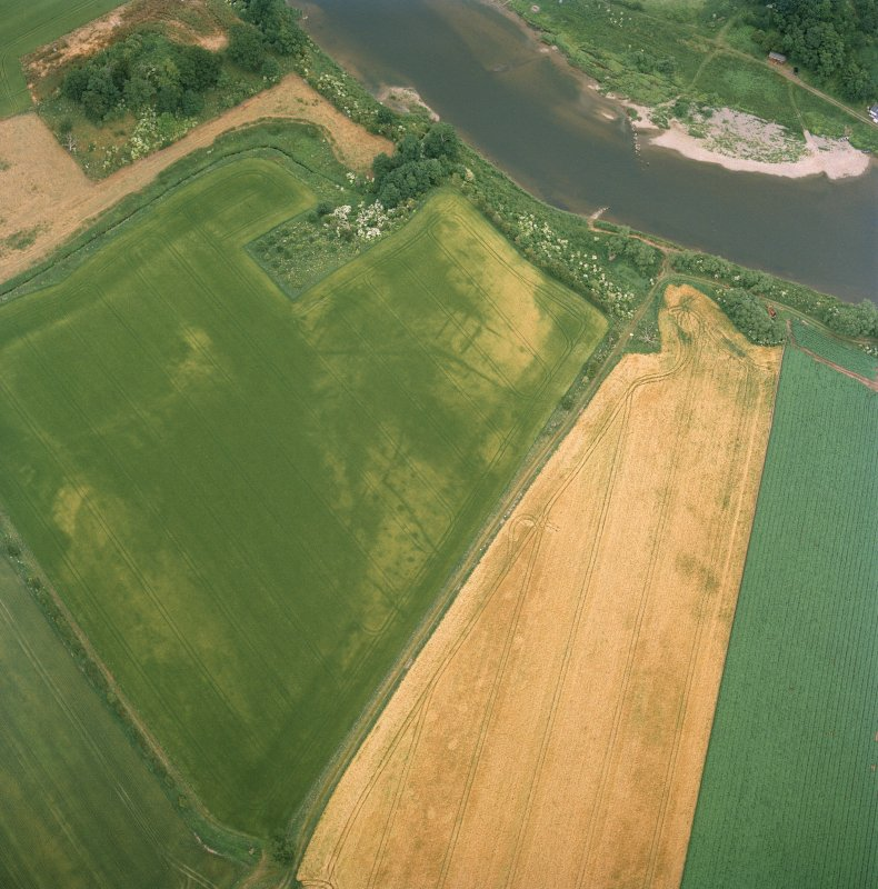 Oblique aerial view centred on the cropmarks of the deserted medieval village, taken from the SW.