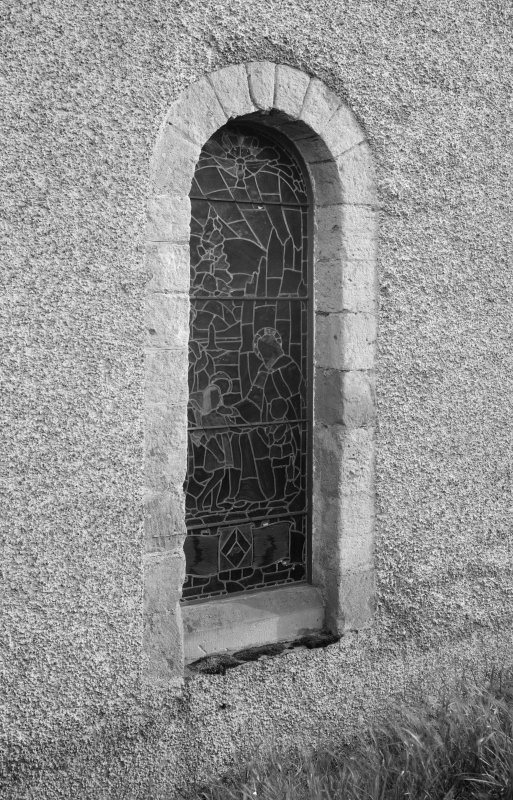 Detail of doorway converted into window in nave's NW elevation.