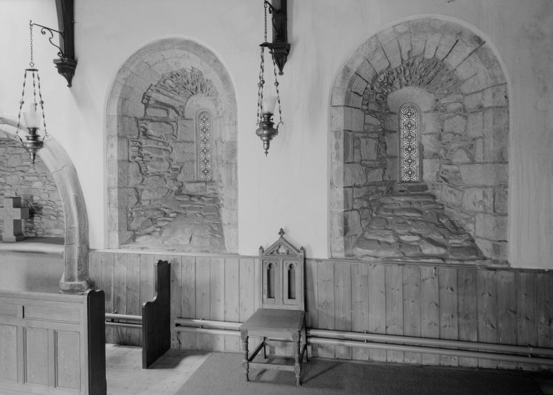 Interior. Chancel, view of NW wall showing original twelfth century windows.