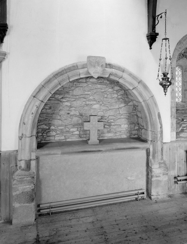 Interior. Chancel, detail of tomb recess in NW wall.