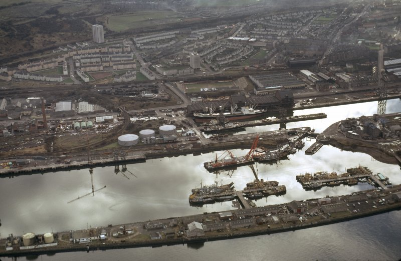 Oblique aerial view of the Great Harbour and James Watt Dock, taken from the NE.