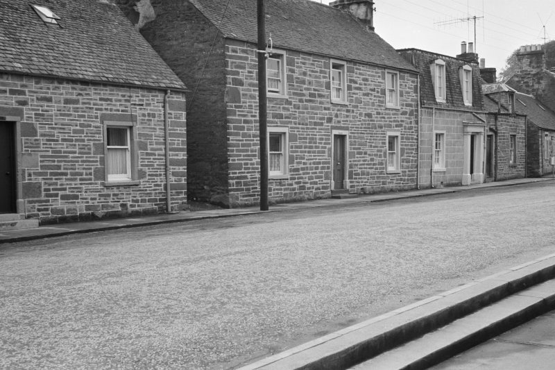 View of houses on the south side of Willoughby Street, Muthill, including Arrascote, Myrtle Cottage and Ingleneuk.