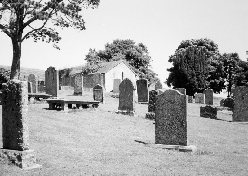 General view of churchyard and burial aisle.