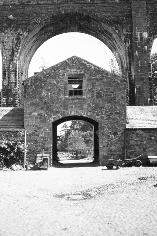 View of steading courtyard and viaduct from NW.