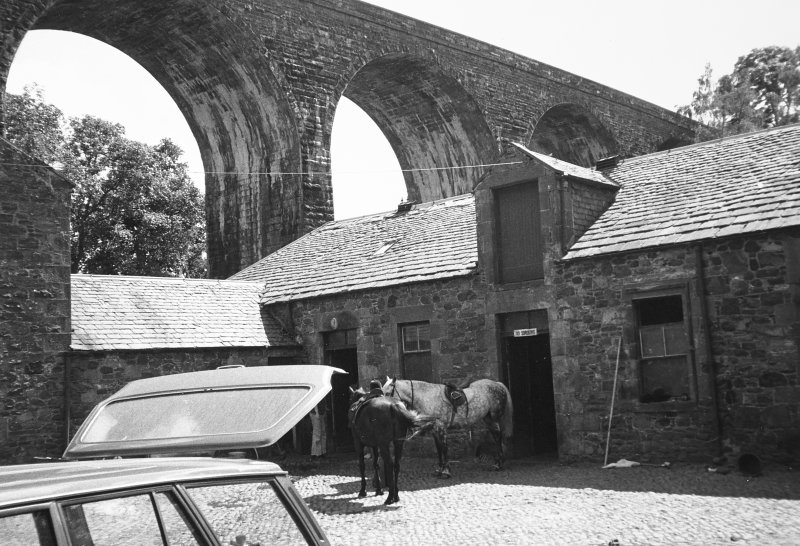 View of steading courtyard and viaduct from N.