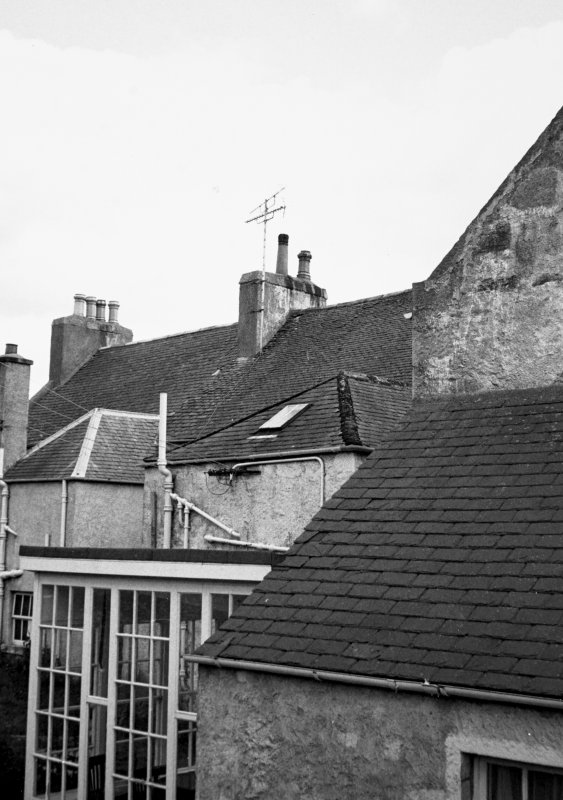 View of roofs and chimneys.