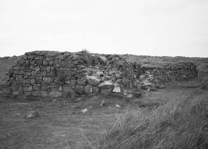 General view of remains of building.