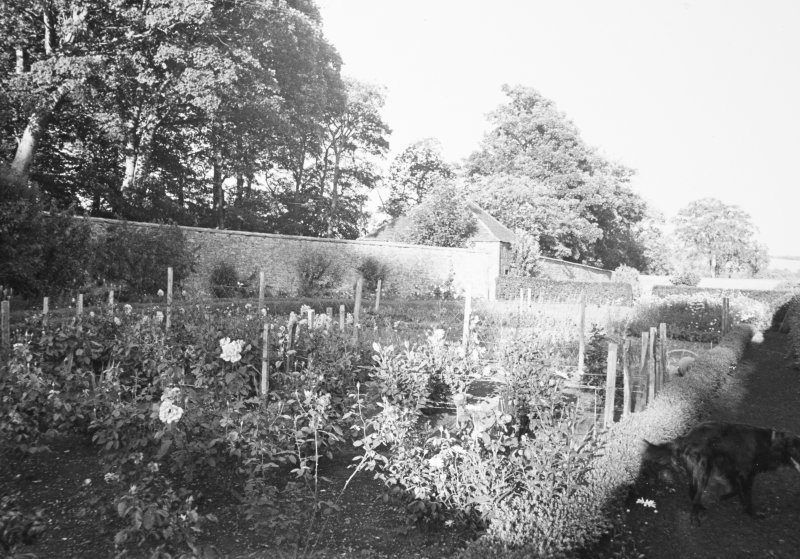 General view of walled garden and building aligned with wall.