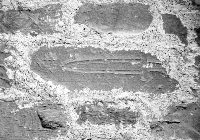 Detail of dagger in wall.