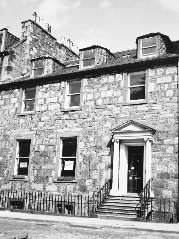 View of the front of the building seen from the South East. In the ground floor windows can be seen two signs with 'Edinburgh Landscape' and 'The End' summing up one person's views on the George Squar ...