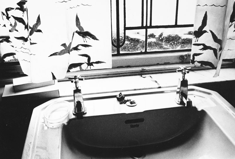 Glasgow, 6 Rowan Road, Craigie Hall, interior. Detail of wash basin and taps in bathroom.