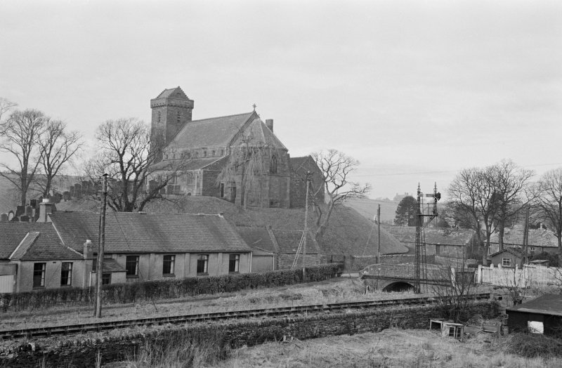 Distant view of St Vigeans Parish Church and churchyard from across the railway line.
