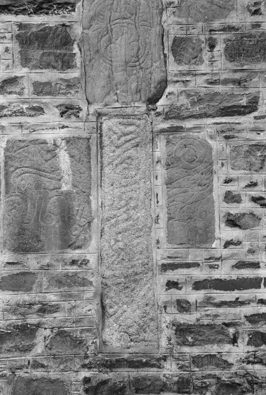 View of Pictish symbol stones and cross-shaft built into gable of  Fyvie Church.
