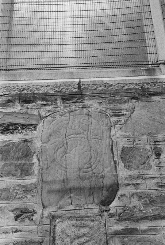 View of Rothiebrisbane Pictish symbol stone built into gable of  Fyvie Church.