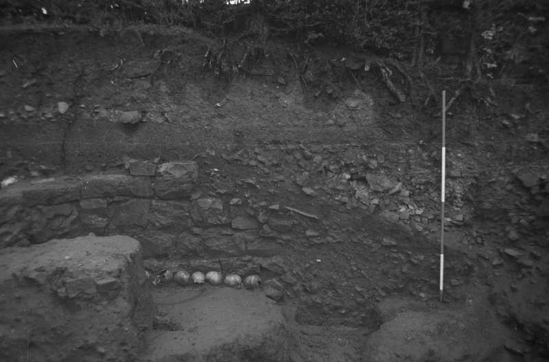 Jedburgh Abbey excavation archive Frame 30: Trench J: E section above 968, from W