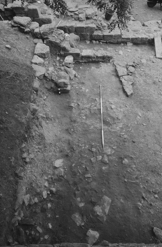 Jedburgh Abbey excavation archive Frame 30: Area 2: Trench A: 303 partially removed. From W.