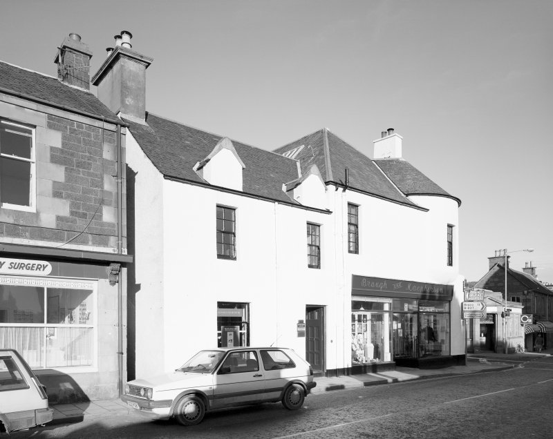 View of 1 Dunira Street, Comrie, showing the premises of Brough and Macpherson from W.