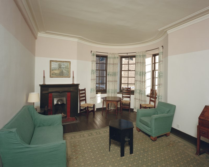 Interior view of 1 Dunira Street, Comrie, showing living room in first floor flat.