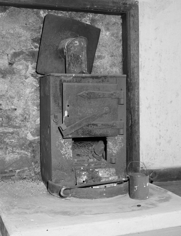 Interior view of 1 Dunira Street, Comrie, showing stove in N attic room.