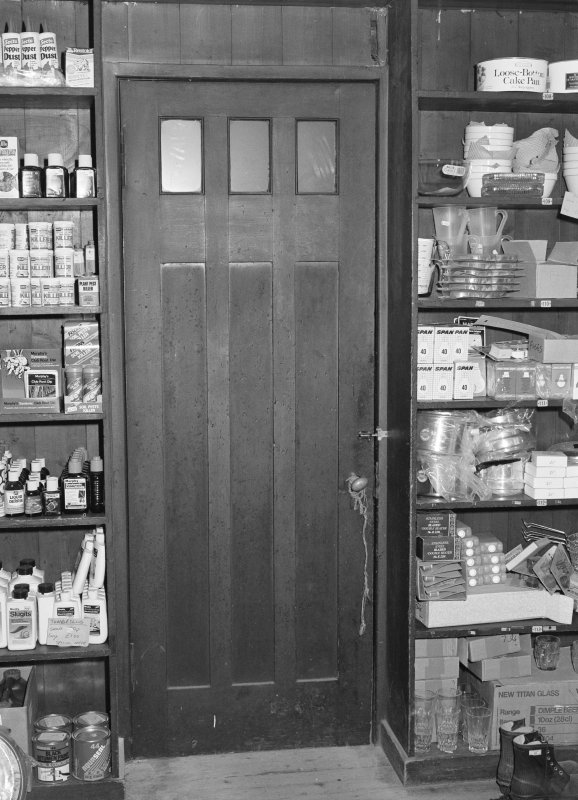 Interior view of 1 Dunira Street, Comrie, showing panelling in counter in the shop of Brough and Macpherson.
