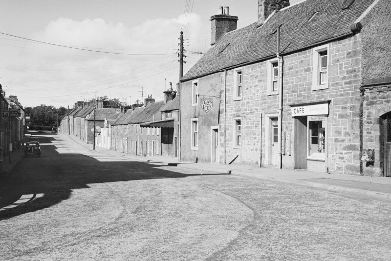 General view of buildings on the north side of Drummond Street, Muthill, including a cafe.