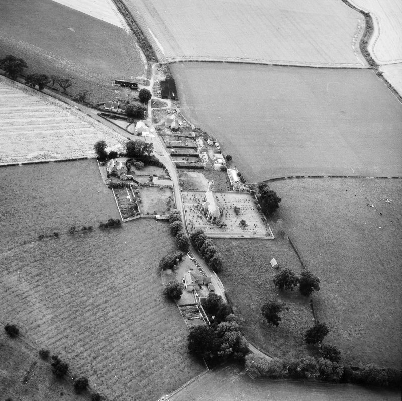 Oblique aerial view centred on church from S.