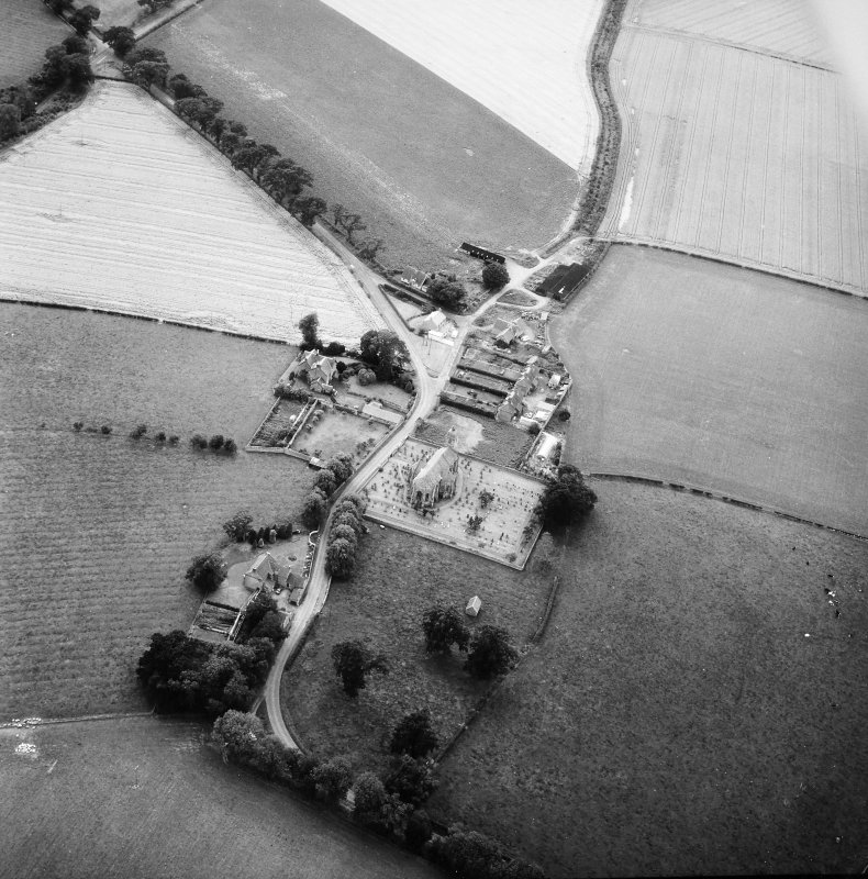 Oblique aerial view centred on church from ENE.