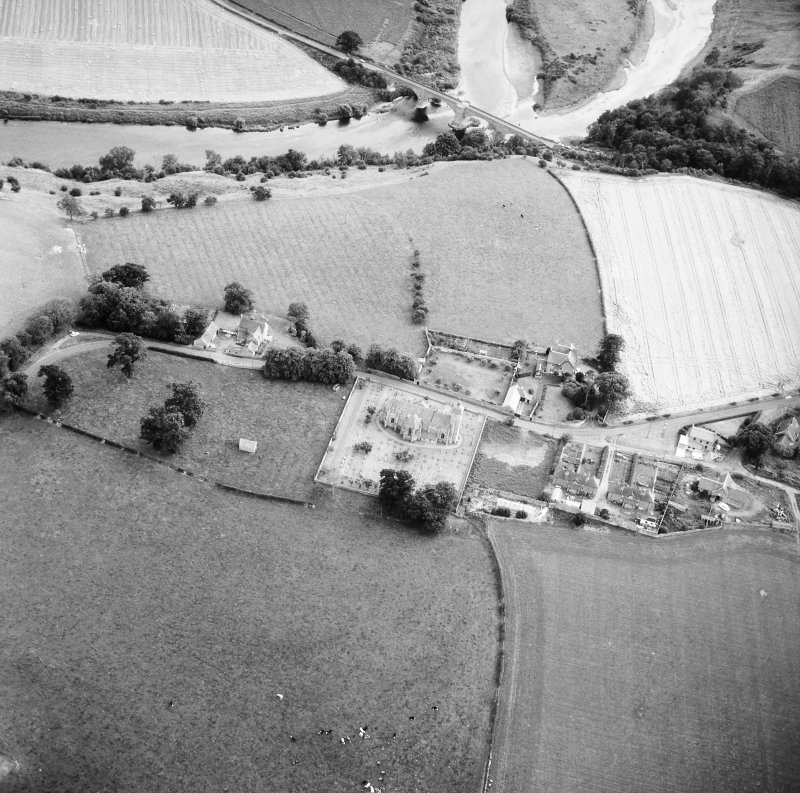 Oblique aerial view centred on church from N.
