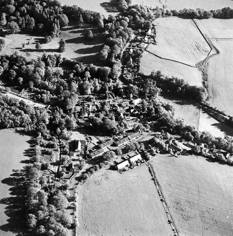 Oblique aerial view centred on the village of Longformacus with walled garden, church and burial ground adjacent, taken from the NNW.