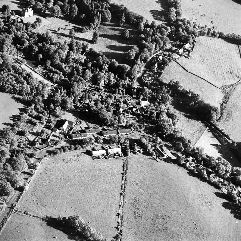 Oblique aerial view centred on the village of Longformacus with country house, walled garden, church and burial ground adjacent, taken from the NW.