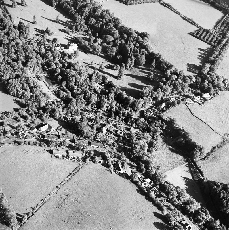 Oblique aerial view centred on the village of Longformacus with country house, walled garden, church and burial ground adjacent, taken from the WNW.