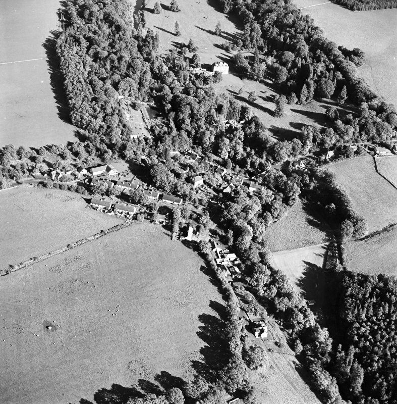 Oblique aerial view centred on the village of Longformacus with country house, walled garden, church and burial ground adjacent, taken from the WSW.