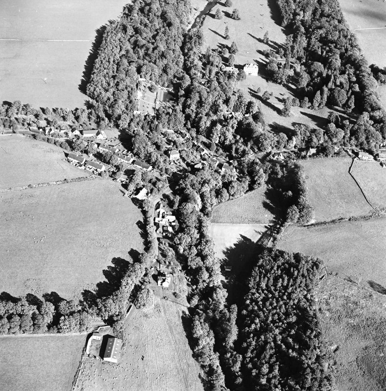 Oblique aerial view centred on the village of Longformacus with country house, walled garden, church and burial ground adjacent, taken from the SW.