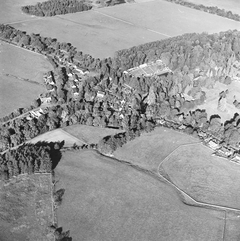 Oblique aerial view centred on the village of Longformacus with walled garden, church and burial ground adjacent, taken from the SW.