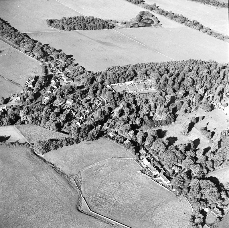 Oblique aerial view centred on the village of Longformacus with walled garden, church and burial ground adjacent, taken from the SSW.