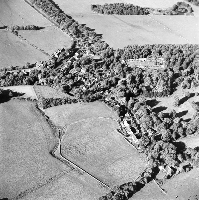 Oblique aerial view centred on the village of Longformacus with walled garden, church and burial ground adjacent, taken from the S.