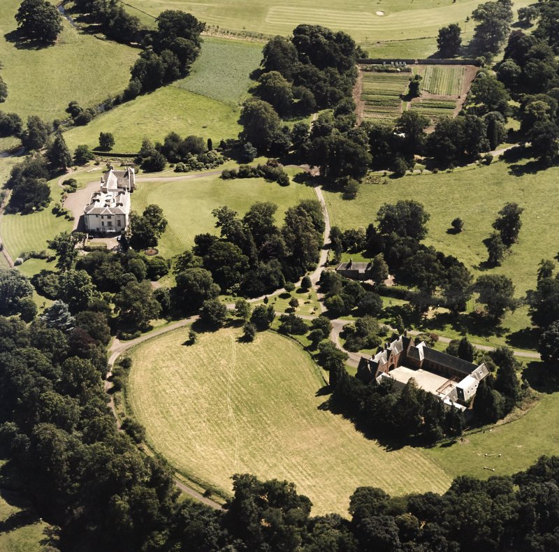 Oblique aerial view centred on the country house and stables, taken from the NNW.