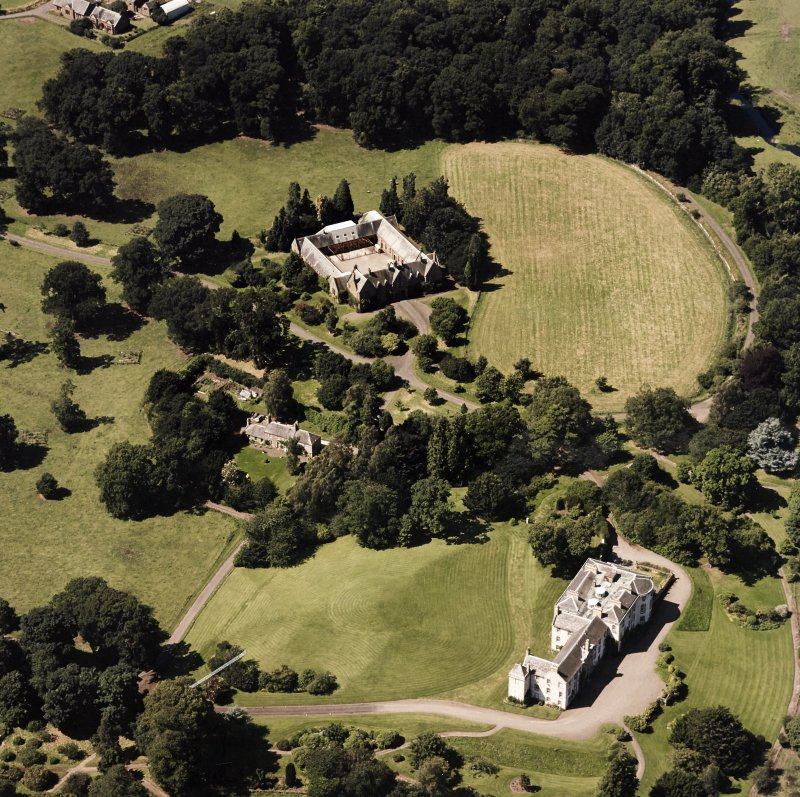 Oblique aerial view centred on the country house and stables, taken from the ESE.