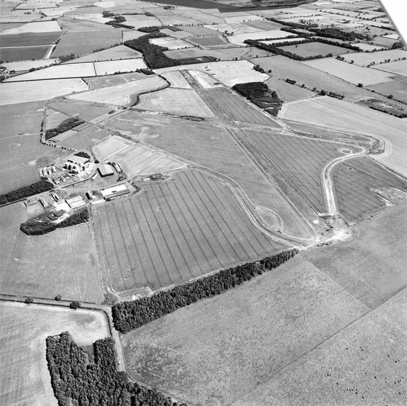 Oblique aerial view centred on the airfield, taken from the W.