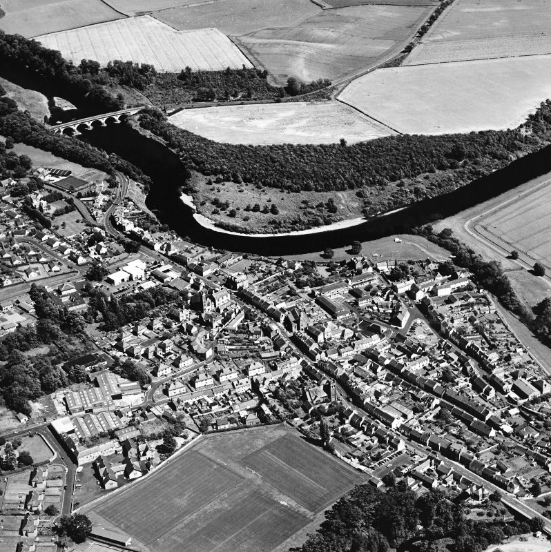Oblique aerial view centred on the town of Coldstream with road bridge adjacent, taken from the W.