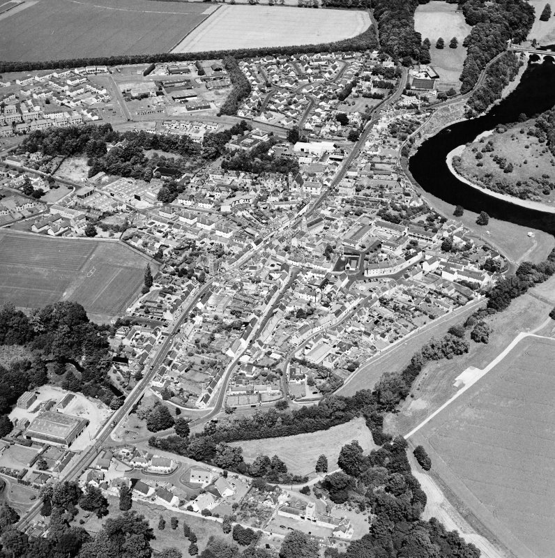 Oblique aerial view centred on the town of Coldstream with road bridge adjacent, taken from the SW.